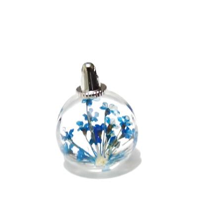 Pandantiv sticla, sferic, 20x15mm, interior floare albastra 1 buc