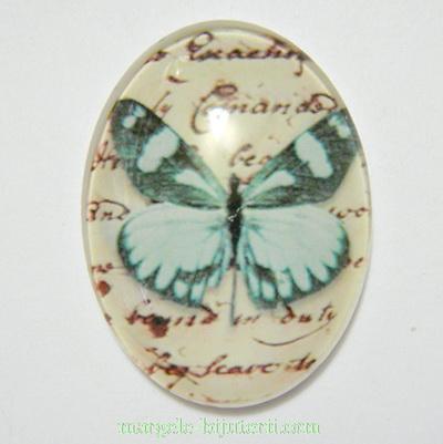 Cabochon oval din sticla, fluturas bleu, 40x30x9mm 1 buc